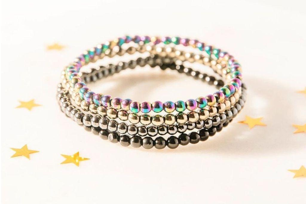Colección de pulseras de piedras preciosas que protegen contra EMF
