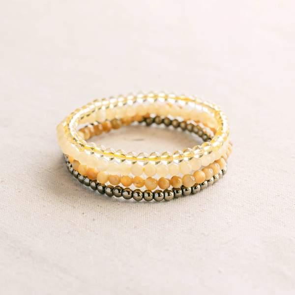 conjunto de pulseras de piedras preciosas para el plexo solar